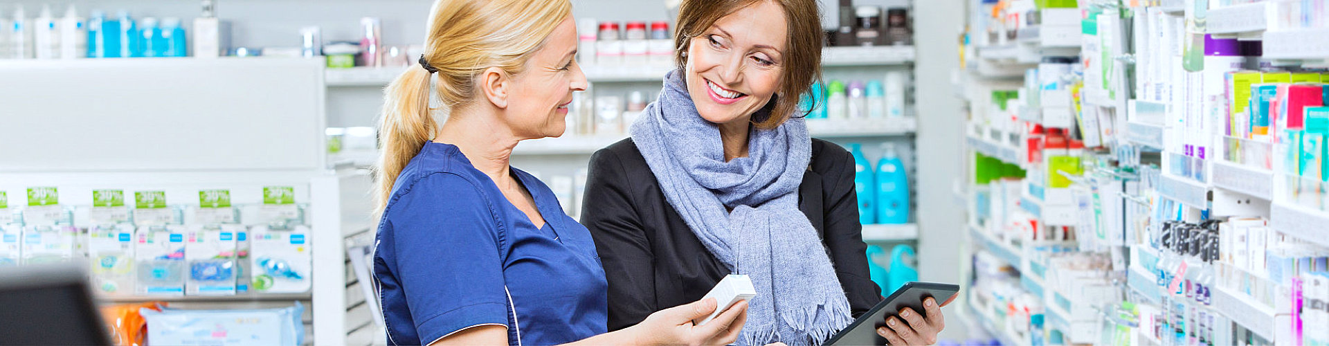pharmacist assisting customers to find what she needs